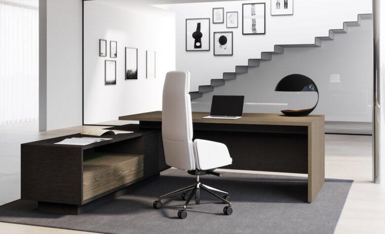 scrivania per architeto angolare in legno scuro con poltrona bianca in pelle